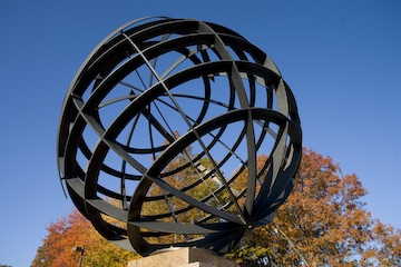 Globe sculpture at entrance to campus